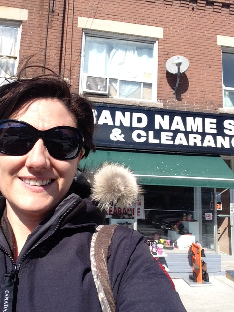 "DECA board member Jodi Shanoff before her favorite ""hidden gem"" on the Danforth -- Brand Name Shoes & Clearance at 2000 Danforth Ave."