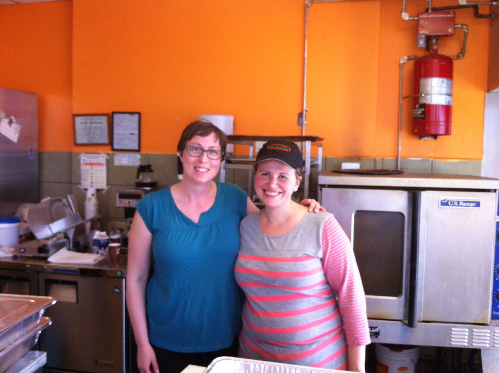 "DECA Chair Sheri Hebdon, left, with Oak Park Deli owner Toula. ""We love the Oak Park Deli for their pizza,"" says Sheri."